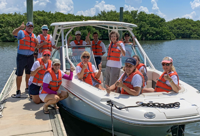 A group of people aboard a boat for boating safety class