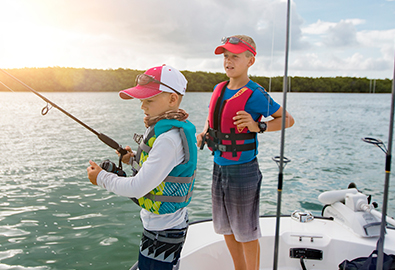 Two kids fishing on a Boston Whaler