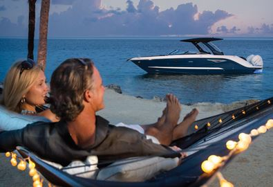 couple relaxing and looking at a anchored boat
