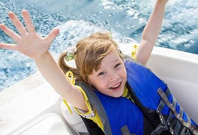 kid having fun on board of a boat