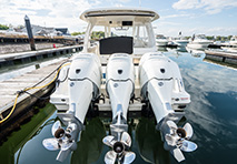 three outboard motors on a boat