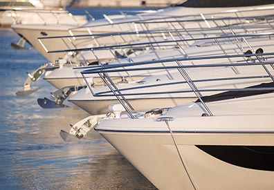 boat bows lined up with water reflecting on them