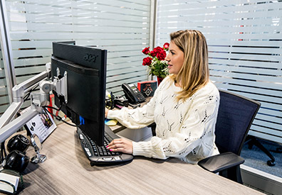 MarineMax Clearwater team member sitting in front of computer