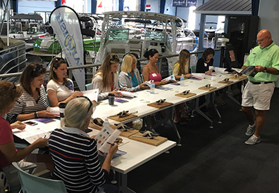 MarineMax Clearwater educational program Women on Board, group of women sitting at a table