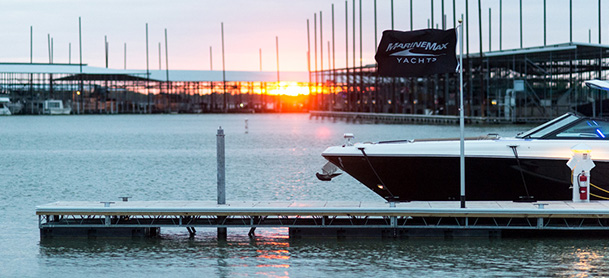 MarineMax Dallas Yacht Center yacht docked with a sunset view