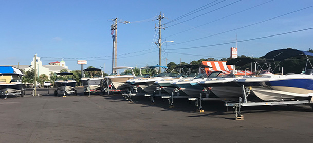 A row of boats in the parking lot of the MarineMax Fort Walton Beach store