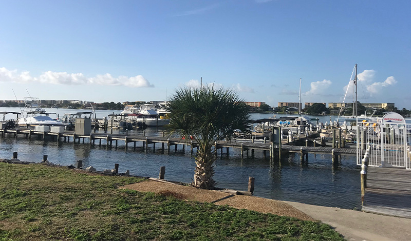 a dock with boats outside the marinemax fort walton beach office