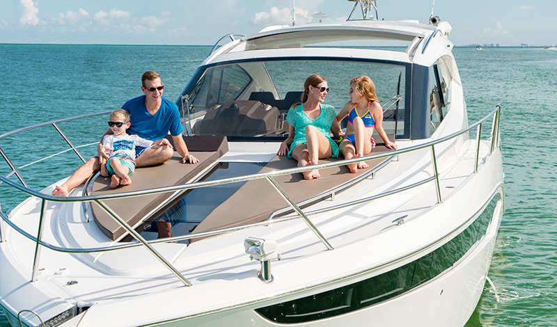 Family on bow of Galeon 385 HTS