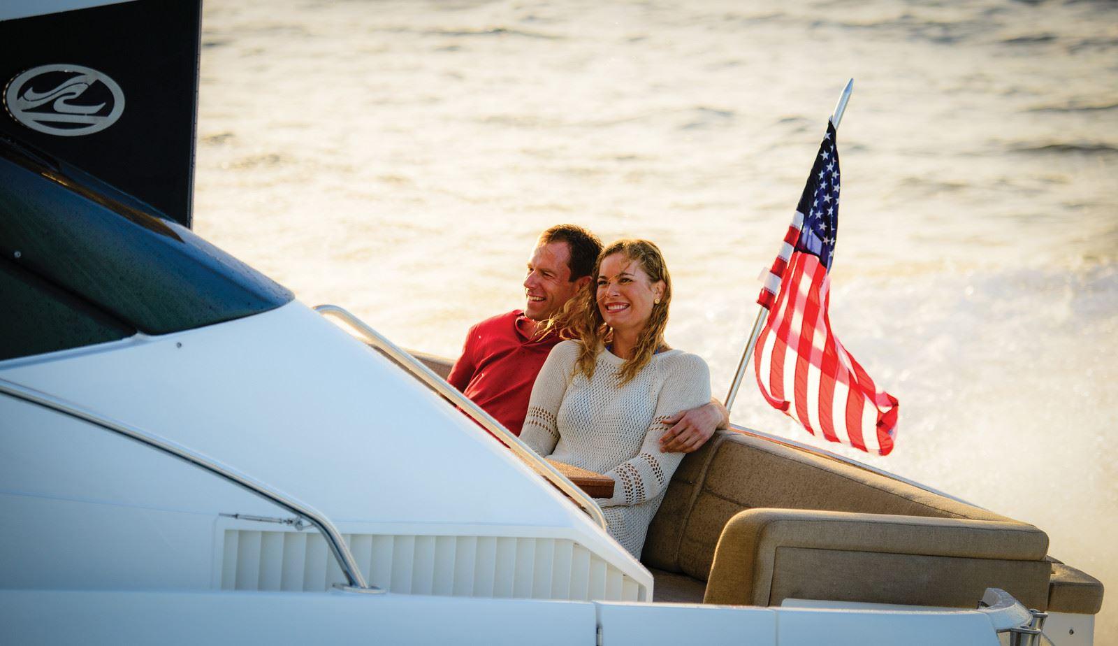 sea-ray-couple-w-flag.jpg