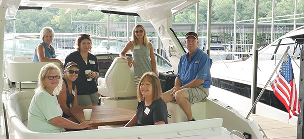 MarineMax Lake Ozark educational program Women on Water, women on board of a white boat