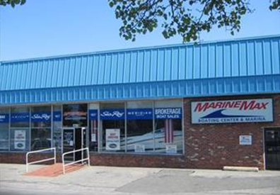 marinemax long island store front - a brick building with a bright blue roof
