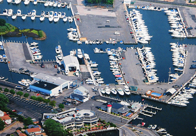 aerial view of the marina with several boats lined up along a series of docks