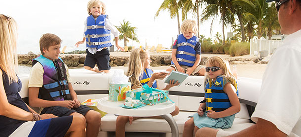 MarineMax Miami Beach Marina educational program Kids in Boating Classes, children on board having fun wearing blue lifejackets