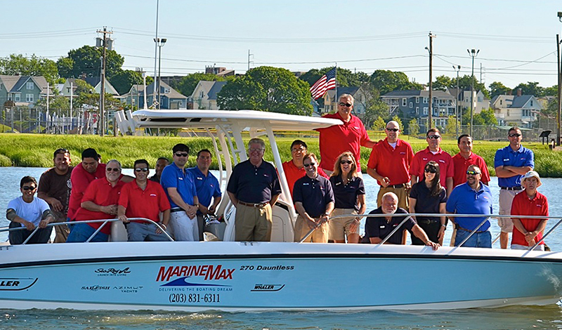 marinemax norwalk team members on board of a boat