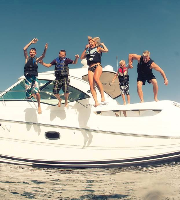 family-jumping-off-boat.jpg