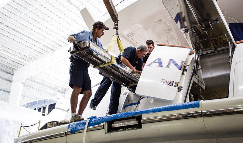 Men working on a yacht at service center