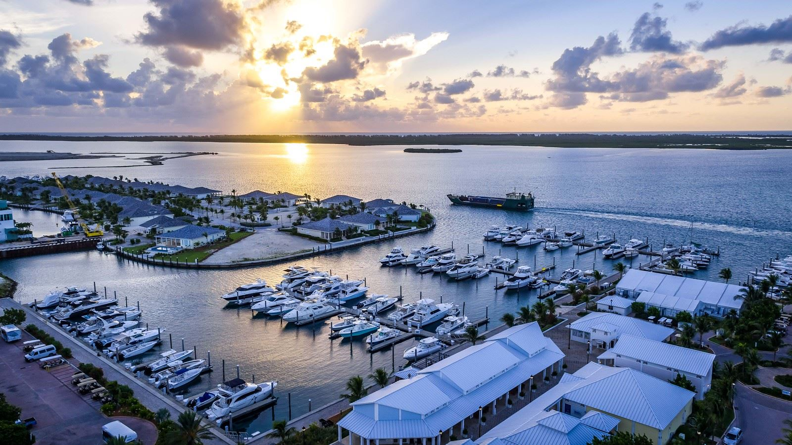sun setting over bahama waters   looking down over many boats docked