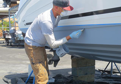 MarineMax Wrightsville Beach team member working on a boat