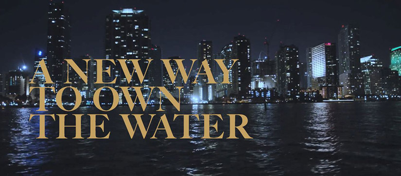 """The words """"A New Way to Own the Water"""" over a background of a city skyline"""