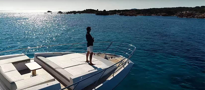 man standing on the bow of an azimut