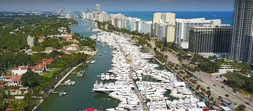 large lineup of boats and yachts in miami
