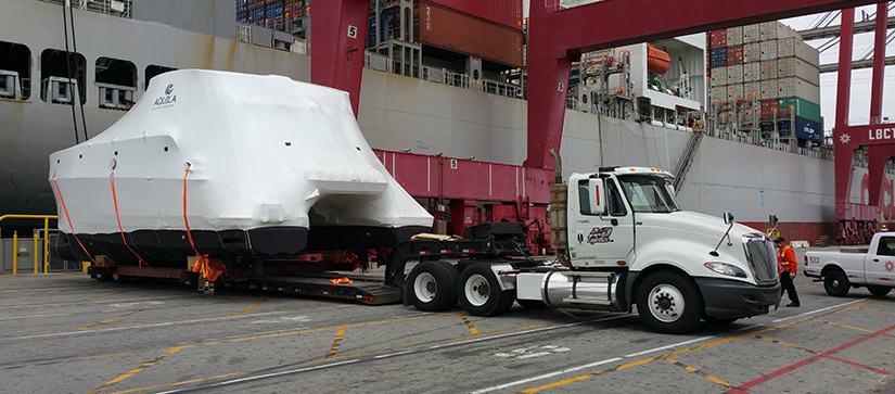 Aquila 44 coming off ship to be transported by semi truck