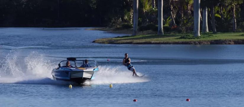 boat on water with waterskiier