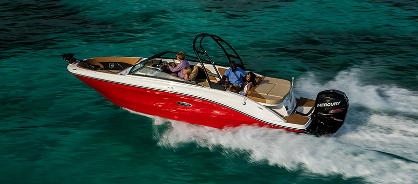 Friends on a Sea Ray SPX 230 OB cruising through water