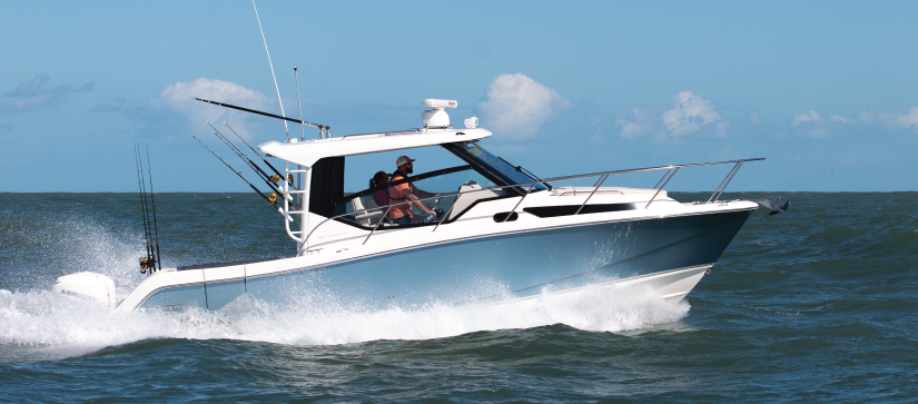 Boston Whaler 325 Conquest running out on the water