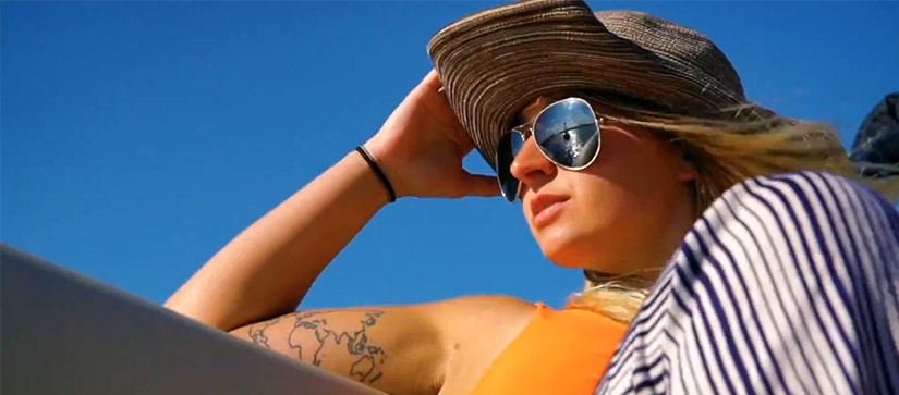 woman wearing hat on a boat