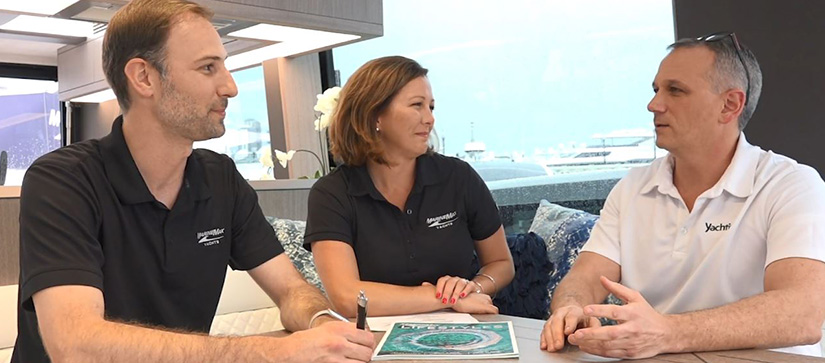Three people sitting in the salon of a yacht