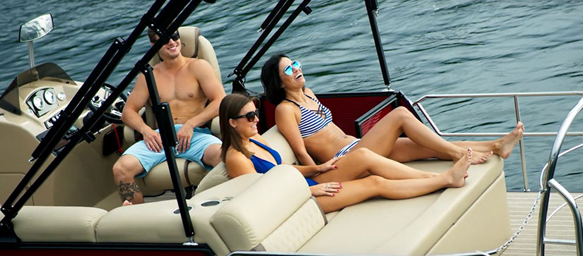 group of people on a pontoon
