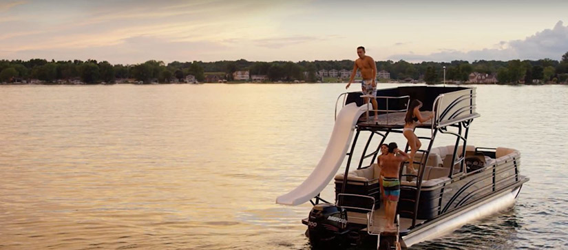 group of people on a pontoon with a slide