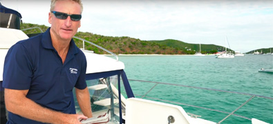 Man on board of a boat - Boating Tip Video for Anchoring with a Windlass