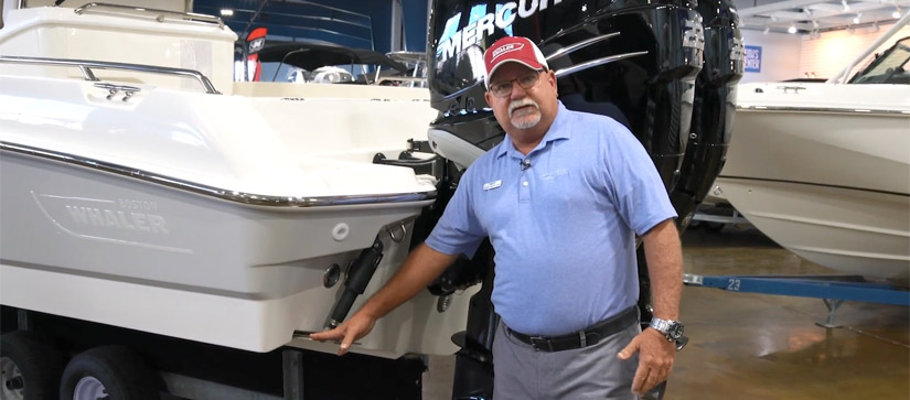 Captain Keith standing beside a trim tab on a boat