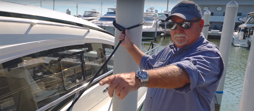 Captain Keith on the docks, tying up a Sea Ray Sundancer 400