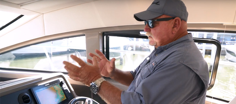 Man talking and moving his hands - MarineMax Boating Tips Video About Cummins Inboard Joystick