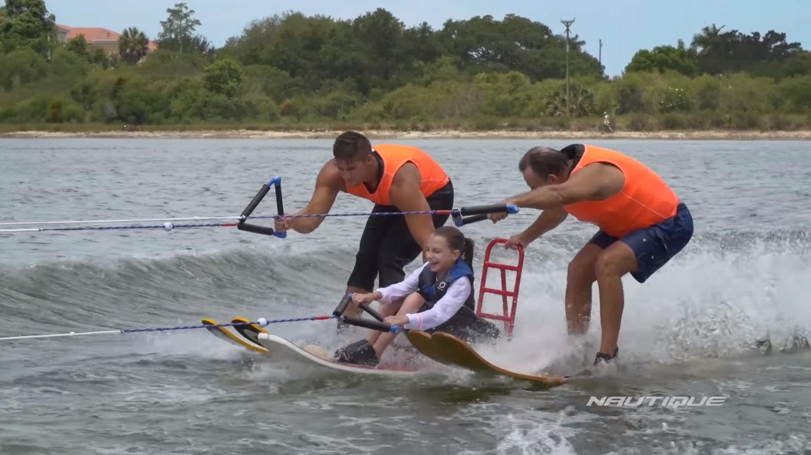 three people waterskiing