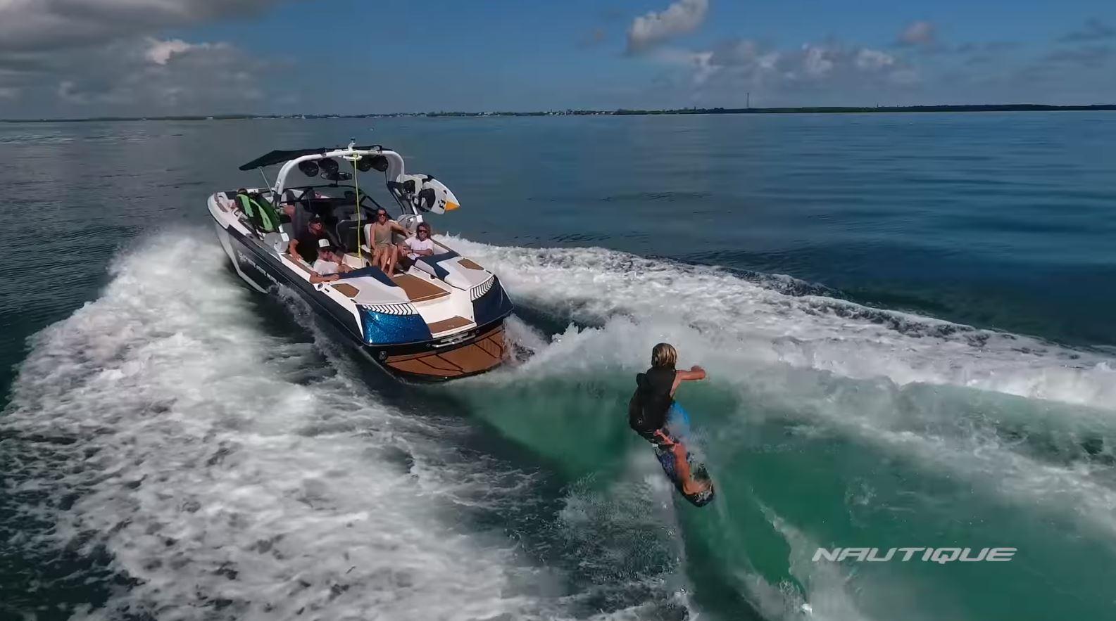 person waterskiing behind boat