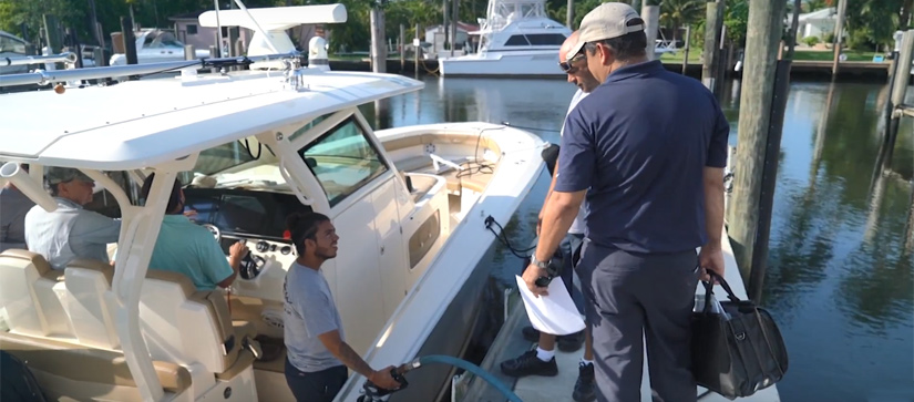 Men on board of a boat talking to men on the dock - MarineMax Miami Service Team Is Committed to You and Your Boat