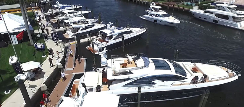A row of boats docked in a marina in Miami
