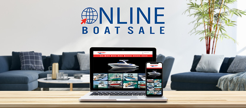 A laptop showing the MarineMax Online Boat Sale