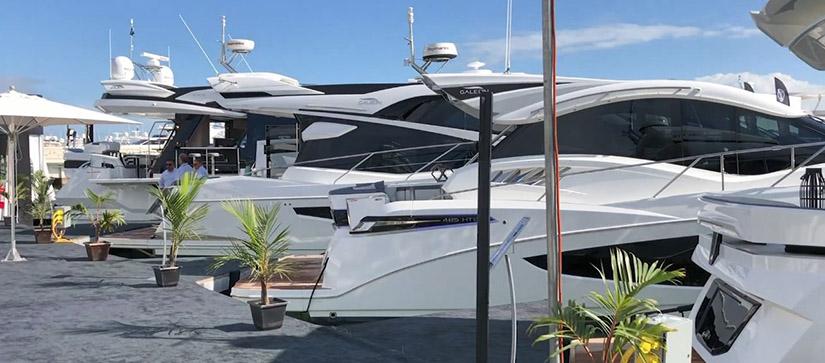 A row of yachts at a marina