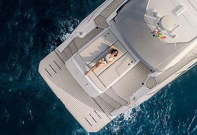 Lady laying on sunpad of a Yacht