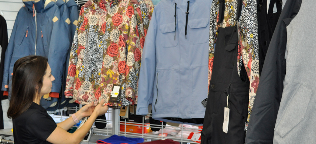 Female looking at winter apparel on rack