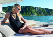 Woman sunbathing on boat