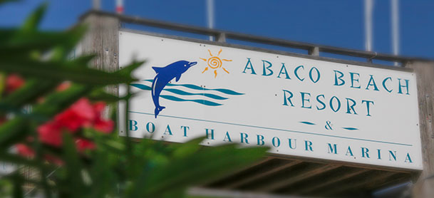 A sign saying Abaco Beach Resort