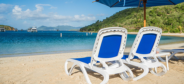 Chairs on a beach in the BVI overlooking the water