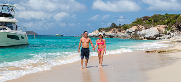 Couple walking along beach in the BVI