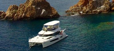 Yacht at sea near islands
